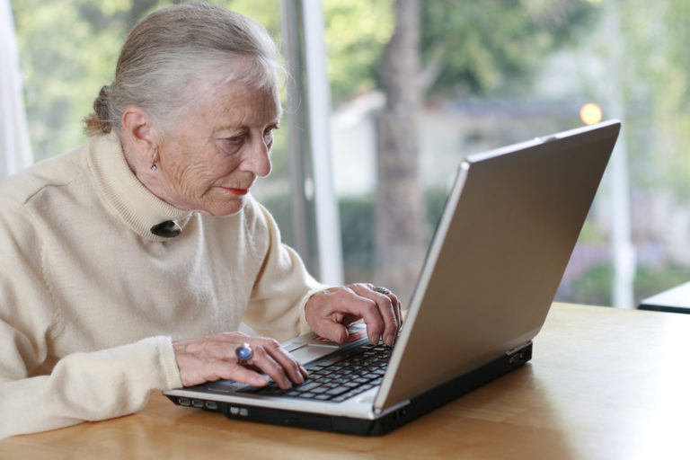 Elderly lady working on estate planning